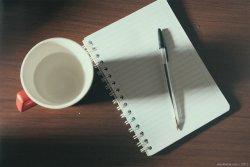 karta długopis i kawa